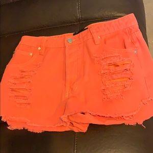 Women medium coral shorts.